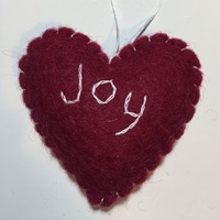 Red Felt Heart with Joy stitched on. 8cm
